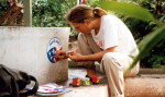 Charles Lewis - Painting the Peace Corps Logo in the Congo